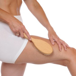 How does a body brush help with cellulite?